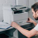 focused male handyman repairing copy